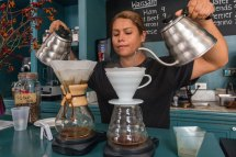 Dueling pour over coffees by the barista at Cafe Unido