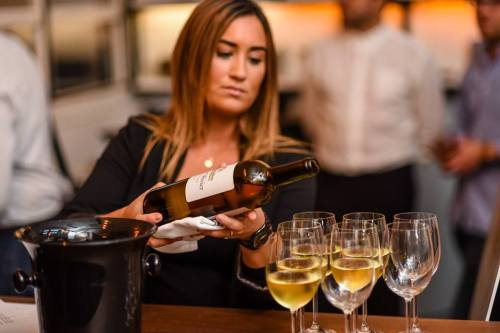 Sommelier Pouring White Bordeaux. (Image Provided by Bordeaux Wine Council)